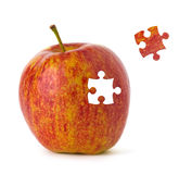 Puzzle Apple. Puzzle red apple on white background Stock Photos