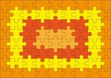 Puzzle arancione Fotografia Stock