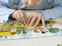 Puzzle assembling Royalty Free Stock Photo