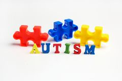 Puzzle: autism awareness day or month concept. On white background Stock Images