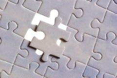 Puzzle avec les disparus d'une seule pièce Photos stock