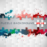 Puzzle background with splashes Stock Images