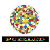 Puzzle ball. With word Puzzled below - also in puzzle pieces Royalty Free Stock Photo