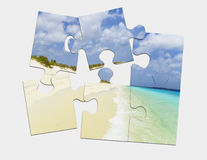 Puzzle beach vacation Stock Photography