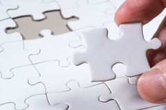 Puzzle in bianco bianco, concetto di affari della soluzione Fotografie Stock