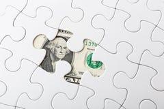 Puzzle bianco e banconota degli Stati Uniti fotografia stock libera da diritti