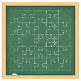 Puzzle on Blackboard. Puzzle with 25 pieces on a blackboard Stock Photo