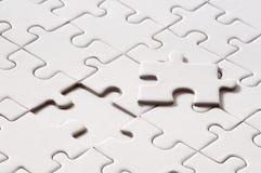 Puzzle blanc avec la partie manquante Photo stock