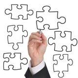 Puzzle blanc d'affaires Photographie stock