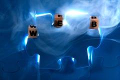 Puzzle bleu avec la lettre en bois photographie stock libre de droits