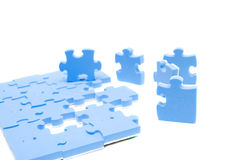 Puzzle blu Immagini Stock