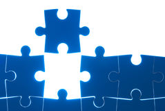 Puzzle blue isolated on white background Stock Images