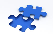 Puzzle blue. Blue puzzle on a white background close-up Royalty Free Stock Photos