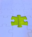 Puzzle board with the green leaf Stock Photography
