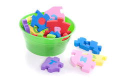 Puzzle in a bucket Stock Photography