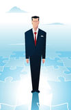 Puzzle. Business man standingover a piece of a puzzle Stock Photography