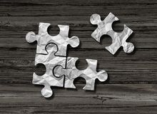 Puzzle Business Solution Concept. As crumpled paper shaped as jigsaw pieces assembled together with one piece joining the group n a 3D illustration style Royalty Free Stock Image