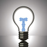Puzzle changing into bulb Royalty Free Stock Image