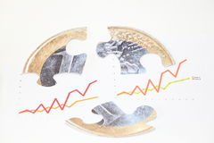Puzzle and charts. Financial concept with euro puzzle and charts stock image