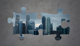 Puzzle of city over gray concrete background Stock Photos