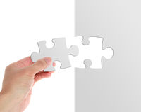 Puzzle. Close up of a puzzle game on white royalty free stock photo
