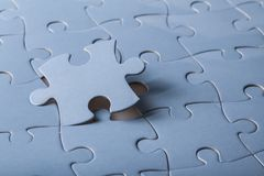 Puzzle. Closeup nobody white assemble struggle challenge Stock Photography