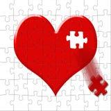 Puzzle-coeur avec la part perdue Photo stock