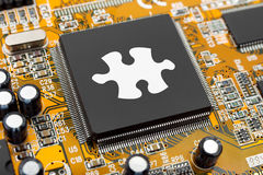Puzzle on computer chip Royalty Free Stock Image