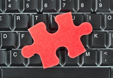 Puzzle and computer keyboard Royalty Free Stock Photos