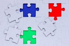 Puzzle con differenti pezzi colorati Fotografia Stock Libera da Diritti
