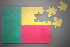 Puzzle con la bandiera nazionale del Benin Fotografie Stock