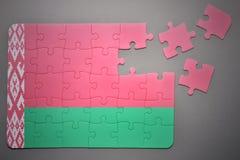 Puzzle con la bandiera nazionale della Bielorussia Fotografie Stock