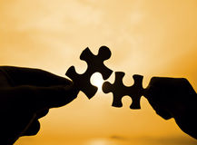 Puzzle connection from two hand Royalty Free Stock Image