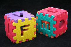 Puzzle cubes with letters Royalty Free Stock Photo