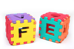Puzzle cubes with letters. And numbers. Multiple colors Royalty Free Stock Photos