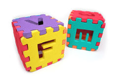 Puzzle cubes with letters. And numbers. Multiple colors royalty free stock images