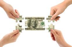 puzzle d'argent de mains Photographie stock libre de droits