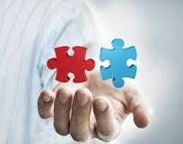 Puzzle dans la main de l'homme d'affaires Image libre de droits