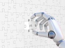 Puzzle dans le robohand Photographie stock libre de droits
