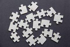 Puzzle on a dark background stock image