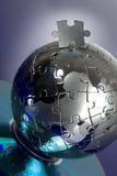 Puzzle de globe avec du CD Images stock