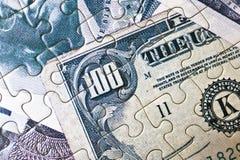 Puzzle dei soldi Immagine Stock