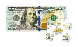 Puzzle dei soldi Immagini Stock