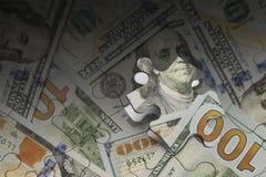 Puzzle dei soldi Immagini Stock Libere da Diritti
