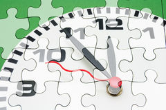 Puzzle del fronte e del puzzle di orologio Immagini Stock Libere da Diritti