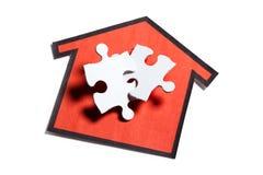 Puzzle dell'alloggiamento Immagine Stock