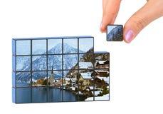 Puzzle dell'Austria di inverno e della mano (la mia foto) Fotografie Stock