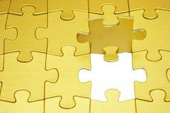 Puzzle dell'oro Fotografie Stock Libere da Diritti