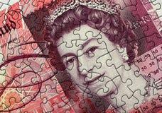Puzzle della nota da cinquanta libbre fotografia stock