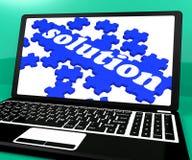Puzzle della soluzione sul taccuino che mostra le applicazioni informatiche Fotografia Stock